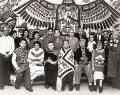Members of Juneau's Tlingit community gather in the Thunderbird House circa 1950.