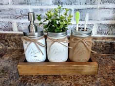 mason jar Bathroom Decor Bathroom set with painted and distressed mason jars, one with a soap pump, one with a toothbrush holder and one either plain or with greenery! Rustic Bathroom Faucets, Mason Jar Bathroom, Bathroom Red, Rustic Bathroom Decor, Rustic Bathrooms, Bathroom Ideas, Red Bathrooms, Bathroom Blinds, Basement Bathroom