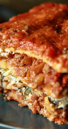 The Best Meat Lasagna ~ Gluten-Free, Dairy-Free and Egg-Free... The most wonderful thick meat and vegetable sauce layered with gluten free lasagna noodles, almond ricotta and spinach and a light fresh tomato sauce. That's it. And the result is out of this world.