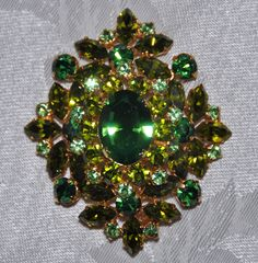 Brooches! The more the merrier for Fall. Like this Vintage 1950s/60s Green Austrian Crystal Brooch. via Etsy.