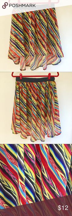 Worn once! Geometric Stripes Hi Lo Skirt Worn once! I got this from Kara's (see Poshpics) cute lil boutique ❤️ but it's a little too big on me.  Bright and vivid chiffon fabric overlays a tighter navy lining. Longer in the back for that flowing look! 100% Poly 💐🌺💐 Mismash Skirts Mini