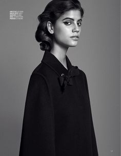 Photographed in black and white, Antonina Petkovic models Fendi black cape and bow