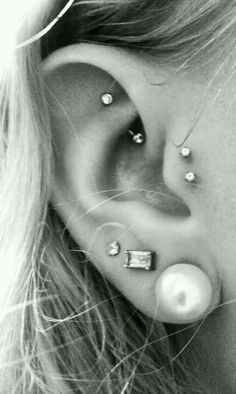 Triple lobe, double tragus and rook piercings. Love. I officially have this, well except for the third libe piercing.