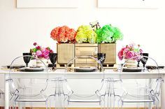 ghost chairs, white table & walls, set the table with bright flowers and gold accents