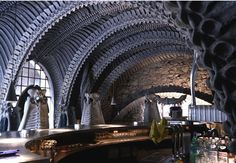 """""""HR Giger Bar: From the mad genius behind the creature designs in Ridley Scott's Alien comes the HR Giger Bar in Switzerland. The skeletal setting invites patrons inside the belly of one of Giger's surreal beasts. Vertebrae arches, eerie relief wallpaper, and chairs that resemble torture devices make for a darkly elegant, intimate gathering like no other."""""""