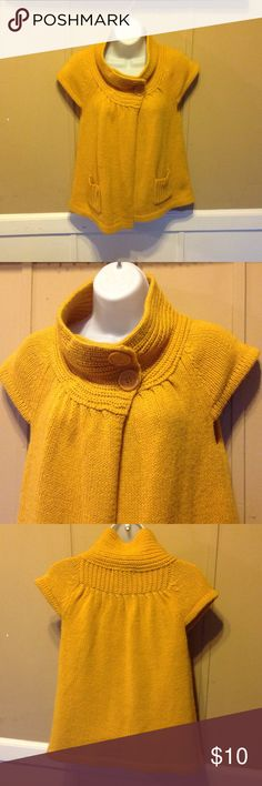 "Shirt Sleeve Sweater Jacket by XXi Shorter Sleeve. Open in front. Closes with two buttons on neckline. Size s. Made by XXi. Great condition. Mustard Yellow. Measures 17"" pit to pit when laid flat. xxi Sweaters Cardigans"