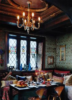 I adore the windows and the ceiling, plus any pile of colorful pillows gets a thumbs-up from me.