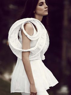 Sculptural Fashion - white dress with braided, spherical sleeve detail; 3d structured fashion