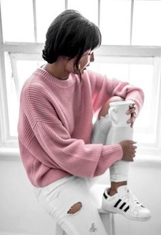 ASOS AsSeenOnMe star wearing an oversized pink jumper with white jeans and white adidas Superstars