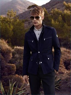 Baptiste Radufe sports a navy field jacket from Lufian's spring-summer 2017 collection.