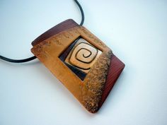 Polymer clay pendant...Love the design and colors. I could do this w/ some of the copper sheets I have leftover!