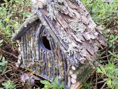 Make a rustic looking birdhouse / pixie house by glueing sticks and bark to a plain wood birdhouse