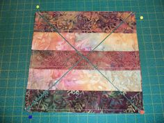 Two squares of strips - place strips opposite directions, right sides together.   Cut diagonally and open!