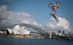 Josh Sheehan of Australia performs the opening jump in the Botanical Garden of Sydney in front of the Harbour Bridge and the Opera House to announce the final stage of the Red Bull X-Fighters World Tour, pic: Sebastian Marko/AFP/GettyImages
