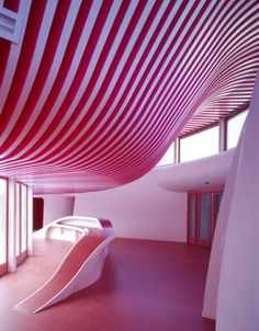 Sarreguemines Nursery in France designed by Michel Grasso - features an organic moulded ceiling and walls.