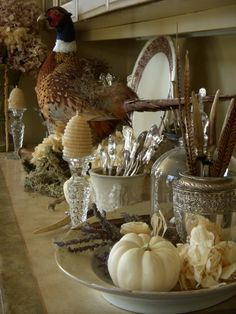 Vintage fall decorating.   #fall #autumn #pheasant #feathers #silver #pumpkin #white #neutral #vintage #decor