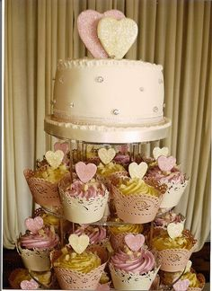 heart-shaped cake and cupcakes with heart top - yellow and pink