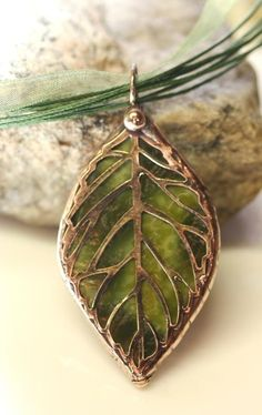 STAINED GLASS LEAF FILIGREE PENDANT by colorshoppestudio, via Etsy.