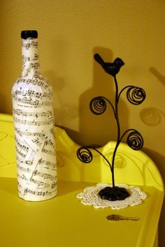 Upcycle:  Old sheet music paired with old wine bottle and a little glue = cute vase.  very creative.