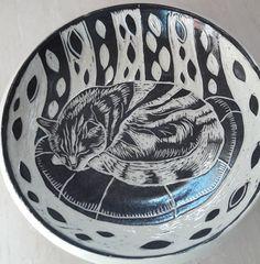 Sgraffito pottery dish Sleeping cat