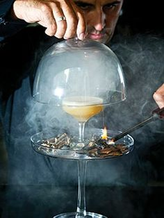 The Gunpowder plot cocktail from Zeta Bar, Sydney. Gin, fernet branca and egg white served in a smoking cloche to infuse a wooden flavour.