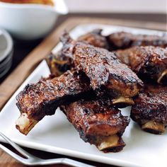 Sticky Barbecued Beef Ribs | These beef ribs—leftovers from the giant rib roast—are incredibly luscious. Chef Tim Love douses them in his sweet and tangy homemade barbecue sauce, then cooks them on the grill until they're crusty, sizzling and outrageously good.