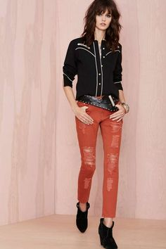 RUST is having a moment! Long overdue, distressed skinny jeans in rust are making the black POP