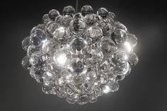 The Taylor Bubble Chandelier from Gilded Home features acrylic balls bound together creating an organic form of lighting. The Taylor light is show stopping and takes all the attention. Place this pendant in the foyer or dining room for a sophisticated look and work everything else around it. It's that amazing!
