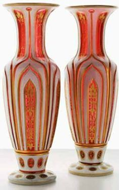 A pair of Bohemian white on ruby overlay vases,