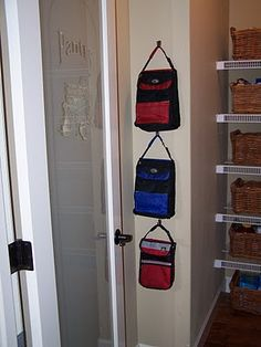 lunch boxes hung on the wall - so smart! I never know where to put them...