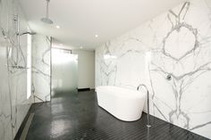 marble bathroom with black floor