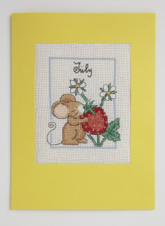 Lucie Heaton's cute critter calendar design is seriously versatile! Here, it's been adapted for a fun greetings card! To find out how, get the full kit, including charts, threads, fabric and instructions, go to http://www.ilovecrossstitch.co.uk/cross-stitch-kits/cross-stitch-magazine-kits