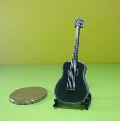 Realistic miniatures musical instrument: acoustic guitar by WizzyArtCreation