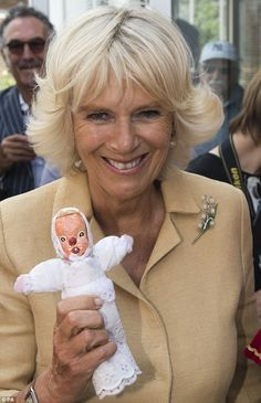 That's the way to do it! The Duchess of Cornwall with a Punch and Judy baby from the fair today