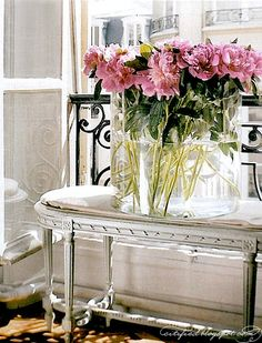 pink peonies on a sun-drenched balcony