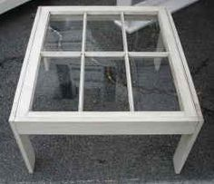 Repurposed window panes into a coffee table, this looks great as is or would look awesome with some accents under the glass.