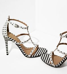 Get spotted in our polka dot and striped Sweetaspie t-strap sandals. | Nine West