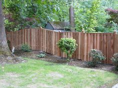 A capped good-neighbor fence with added density by wymanconstruction, via Flickr