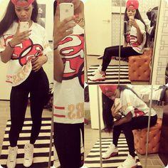 Teyana Taylor wearing Air Jordan XIII 13 White Red