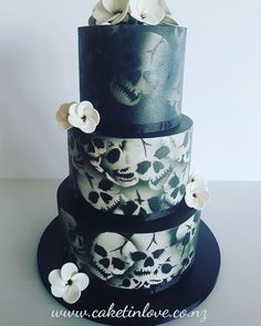 "A cool and very different wedding cake. 10"" chocolate mud cake filled with chocolate ganache, 8"" carrot cake filled with cream cheese Italian meringue butter cream and 6"" white chocolate cake filled with whipped white chocolate. Sugar fragipanis and airbrushed skulls. This was so much fun to make. Skull stencil from Kat at Ibicci White Chocolate Cake, Chocolate Ganache, Different Wedding Cakes, Skull Stencil, Italian Meringue, Carrot Cake, Designer Wedding Dresses, Skulls, Butter"