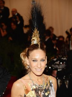 2013 Met Gala: Sarah Jessica Parker ( <3 her sense of style & the risks she takes) Giles Dress, Philip Treacy Mohawk Hat - 1 of these days I will own one of his hats!!!