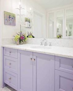 Who says cabinetry can't be whimsical? 💕 We love it when we get to paint cabinetry in fun colors like we did here for Bradshaw Designs! Lavender Kitchen, Lavender Bathroom, Purple Bathrooms, Chic Bathrooms, Purple Cabinets, Painted Vanity, Bath Cabinets, Painting Cabinets, Bathroom Interior Design