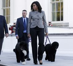 Wearing a tailored pantsuit for the delivery of the White House's Christmas tree in D.C.    - HarpersBAZAAR.com