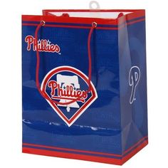 "MLB Philadelphia Phillies Gift Bag, Medium by PSG. $5.49. Gift Bag Medium. MLB. Philadelphia Phillies. MLB Team Logo Gift Bags. These full color team logo gift bags are a great way to present gifts to that special someone. Each bag features multiple officially licensed team logos and colors. Bags are made from heavy paper, feature team color handles and are 7.5"" by 4.75"" x 9.75"" high."