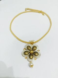 Glorious Gold Pendent set with Pearl to adorn your Beauty. A mix of Traditional design with Mordern touch.