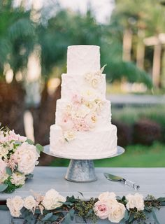 Four tier textured ivory and blush flower wrapped wedding cake: http://www.stylemepretty.com/little-black-book-blog/2016/10/10/romantic-pasadena-garden-estate-wedding/ Photography: The Great Romance - http://thegreatromancephoto.com/