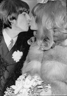 JANUARY 22, 1966: Beatle George Harrison and bride Pattie Boyd kissing