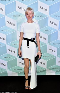 Picture perfect: The 36-year-old beauty showed her sleek figure in a white dress