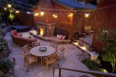 fireplace; seating; patio; string lights
