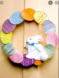 Paper Crafting - Home Decor Patterns Irresistible pastel eggs with faux icing decorate your wall or front door for a seasonal delight. wreath is decorated with 12 hand-crafted paper eggs and an adorable paper bunny. Easter Crafts For Toddlers, Toddler Crafts, Paper Bunny, Diy Ostern, Easter Crochet, Easter Wreaths, Holiday Crafts, Easter Eggs, Creations